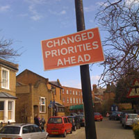Changed Priorities sign in London